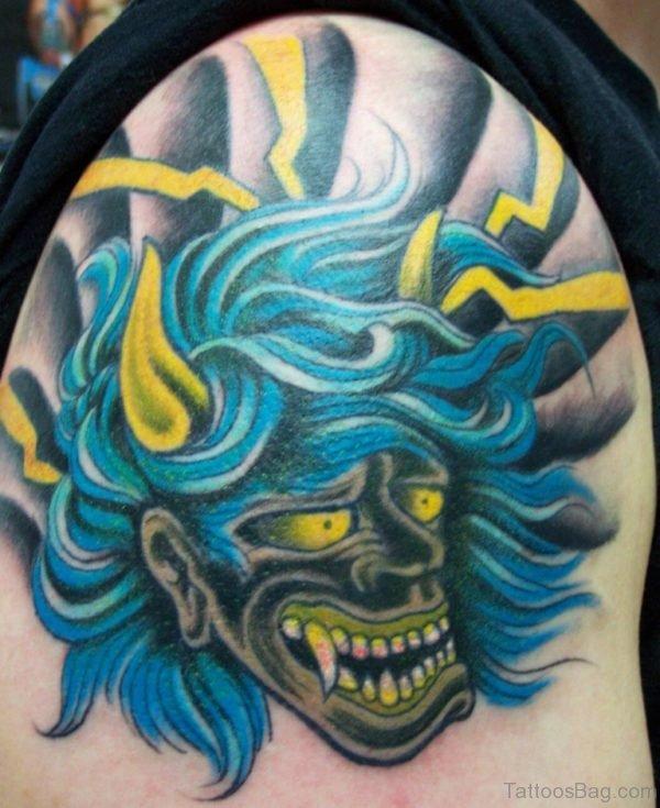 Oni Mask Tattoo On Shoulder