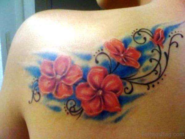 Orange Flower Tattoo On Shoulder