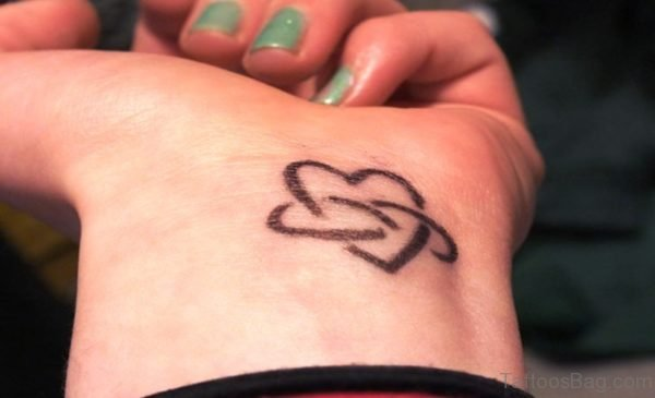 Outer Heart Tattoo On Wrist