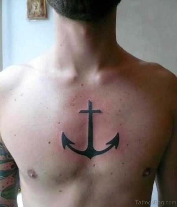 Outstanding Anchor And Cross Tattoo On Chest