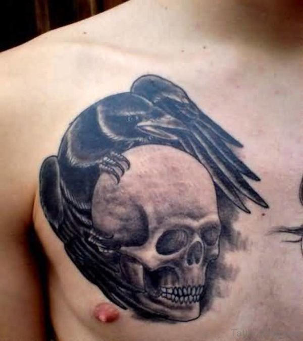 Outstanding Angry Black Crow On Skull Tattoo On Chest