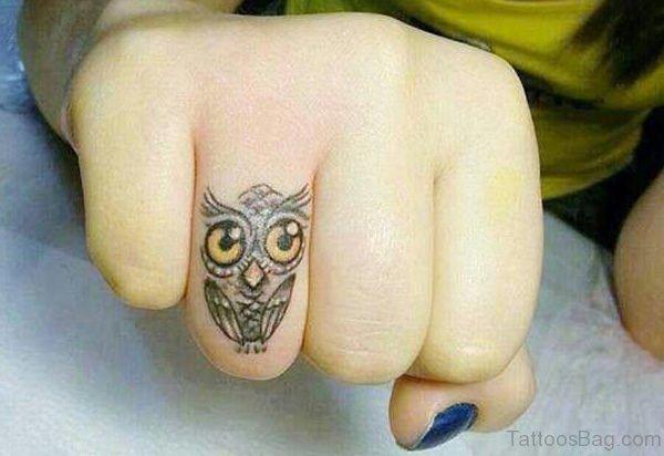 Owl Eyes Tattoo On Finger