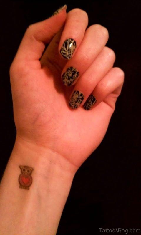 Owl With Heart Wrist Tattoo