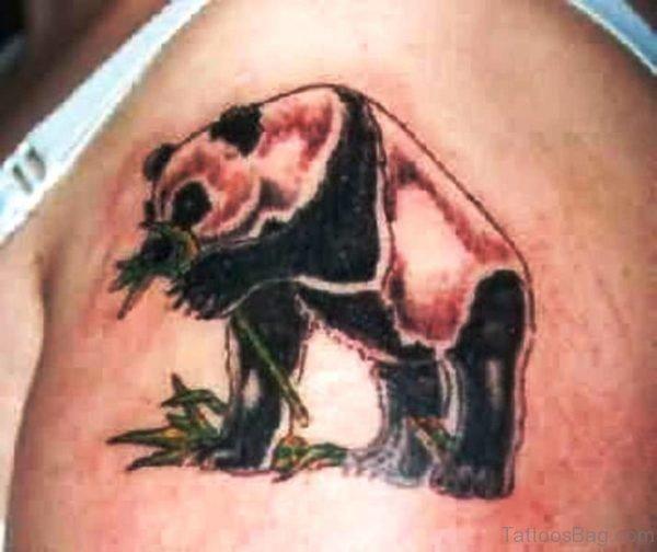 Panda Eating Grass Shoulder Tattoo