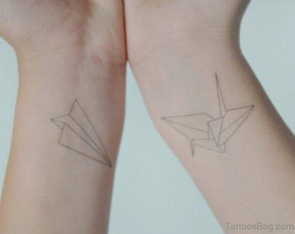 Paper Plane Wrist Tattoo