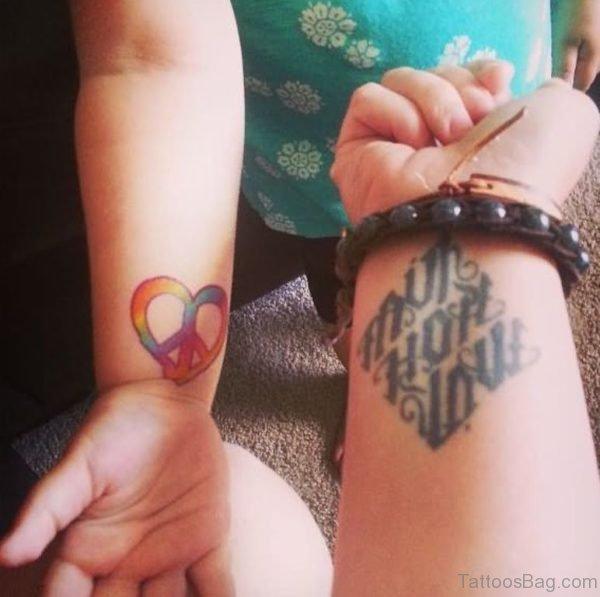 Peace Symbol and Faith Hope Ambigram Tattoo