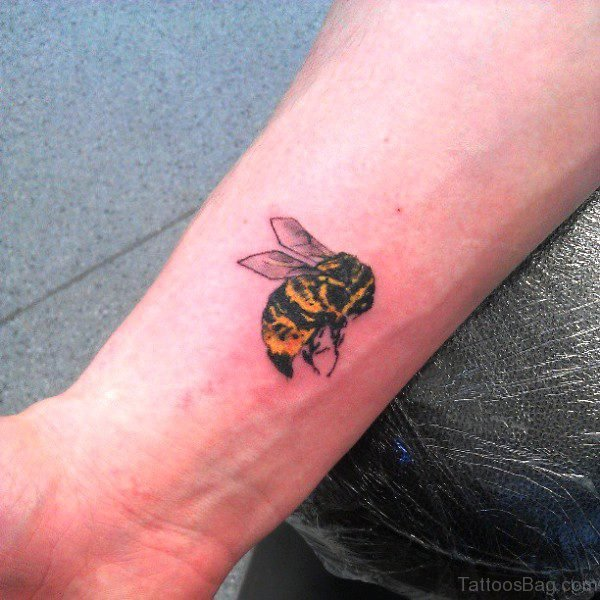 Phenomenal Yellow Bee Tattoo On Wrist