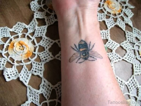 Photo Of Bee Tattoo On Wrist
