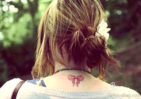 Pink Bow Tattoo On Neck