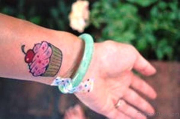 Pink Cupcake Tattoo On Wrist