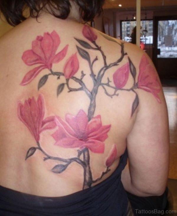Pink magnolia Flower Tattoo On Upper Back