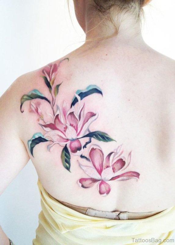 Pink magnolia flower tattoo