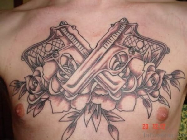 Pistol And Rose Tattoo On Chest