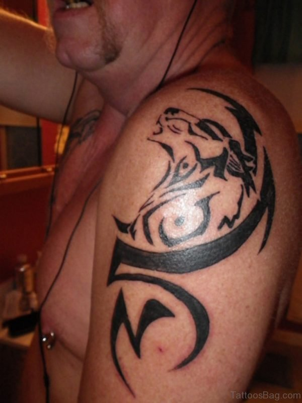 Proud Tribal Wolf Tattoo On Shoulder