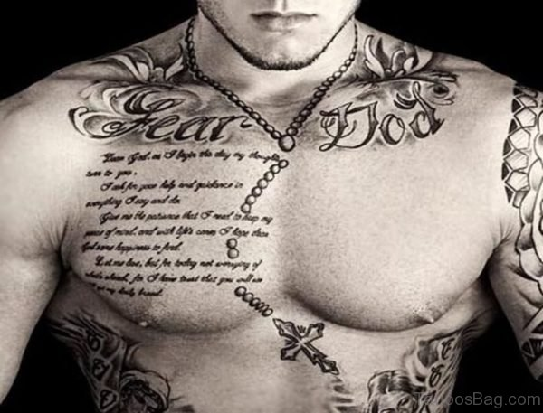 Quote With Rosary Cross Tattoo On Man Chest
