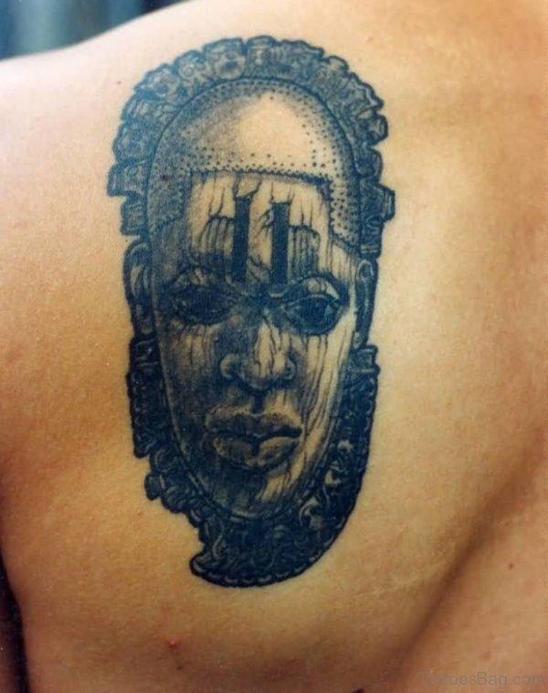 Rare Face Mask Back Tattoo