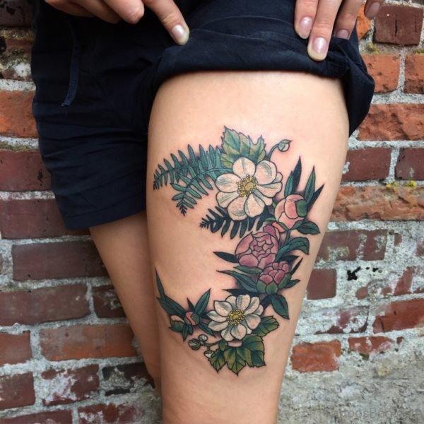 Ravishing Rose Tattoo On Thigh