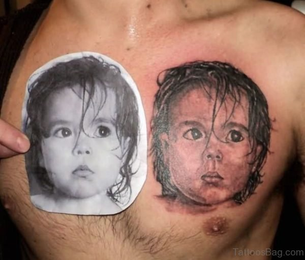 Realistic Baby Face Portrait Tattoo On Man Chest