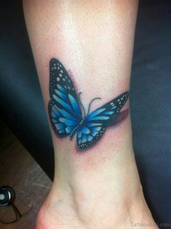 Realistic Black And Blue Butterfly Tattoo On Ankle