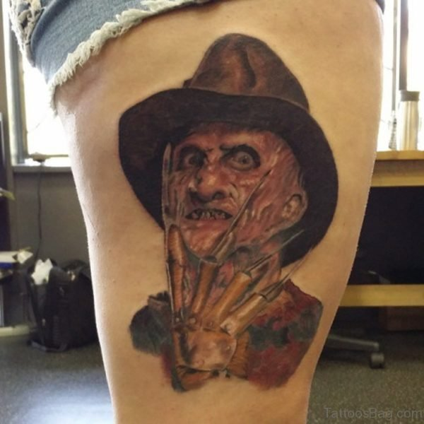 Realistic Color Angry Freddy Krueger Portrait Tattoo On Thigh