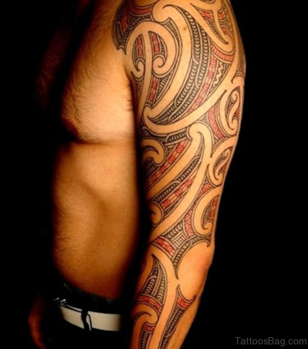 Red And Black Ink Tribal Tattoo On Chest