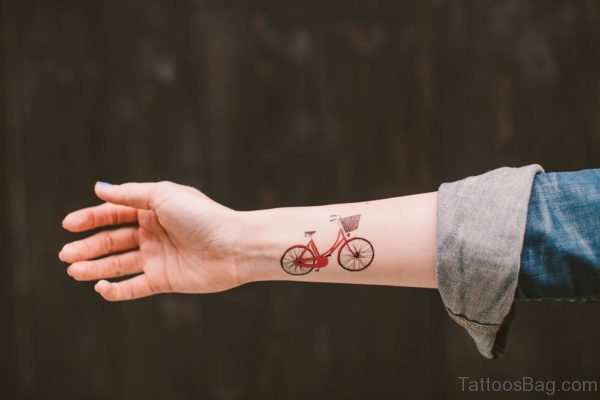 Red Cycle Tattoo On Wrist