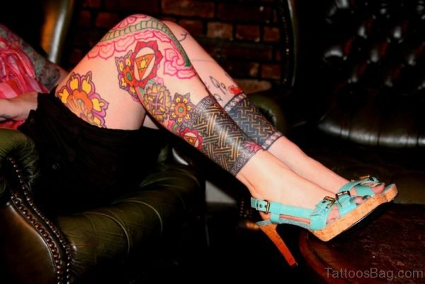 Red Ink Tribal Tattoo On Leg