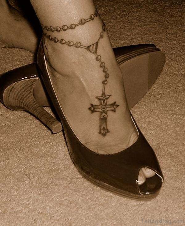 Red Rosary On Ankle Tattoo