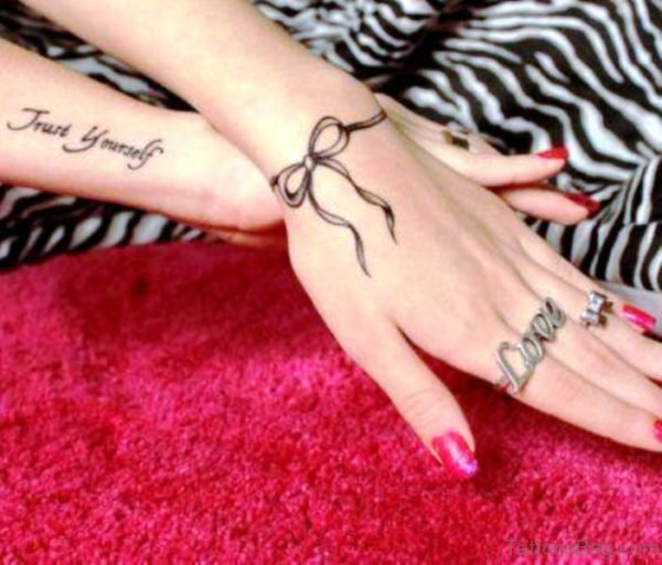 Ribbon Bow Tattoo On Wrist