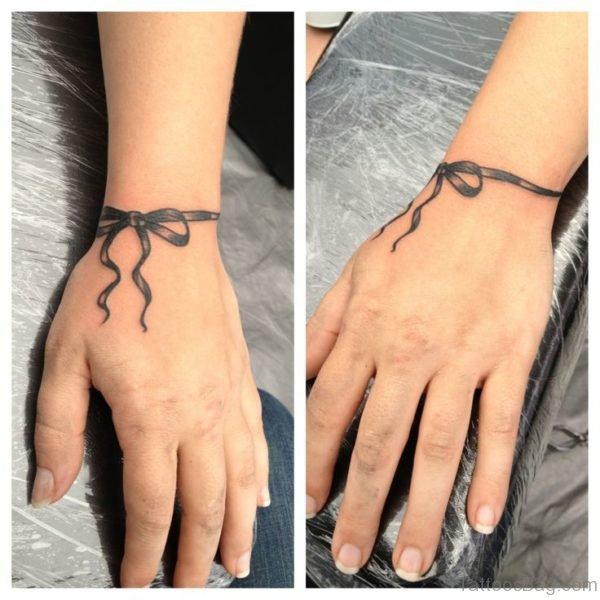 Ribbon Wrist Tattoo