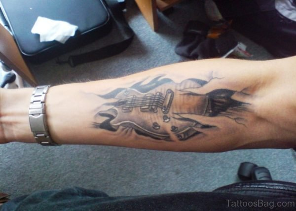 Ripped Guitar Tattoo On Forearm
