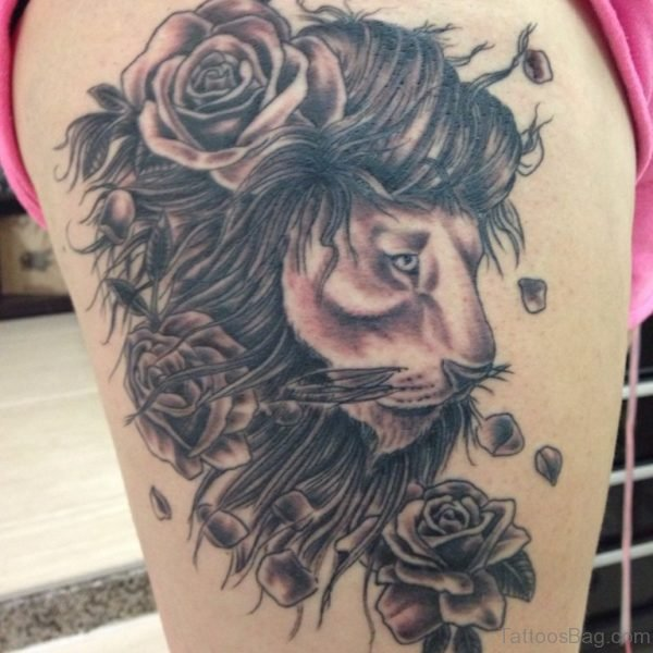 Rose And Angry Lion Tattoo On Thigh