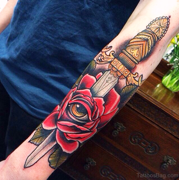 Rose And Dagger Tattoo On Arm