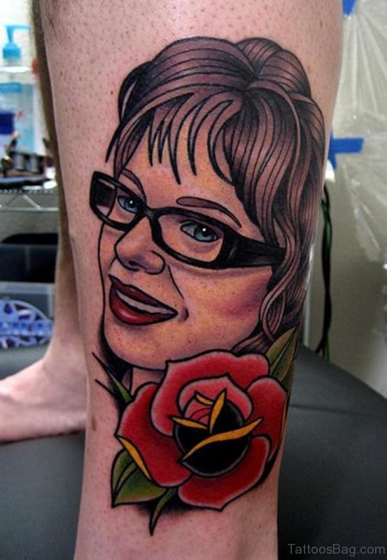 Rose And Portrait Tattoo On Leg