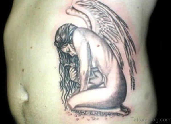 Sad Angel Grey Ink Tattoo