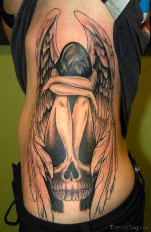 Sad Angel Tattoo On Rib