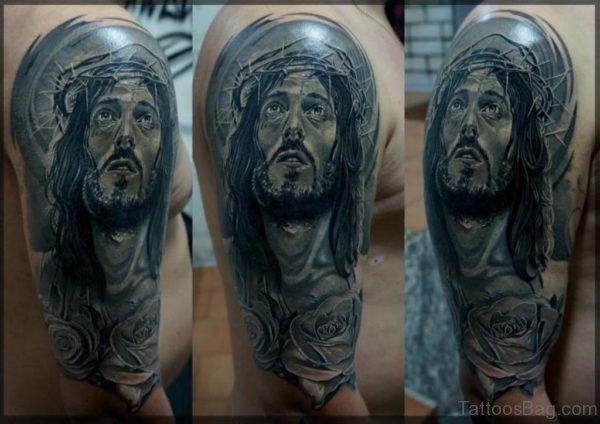 Sad Jesus Tattoo On Right Shoulder