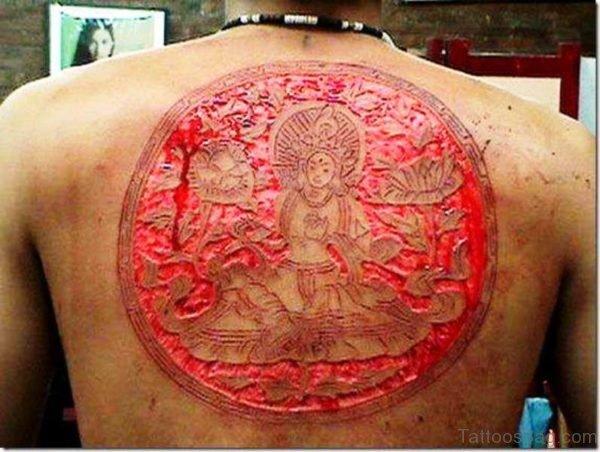 Scarification Buddha Tattoo On Back