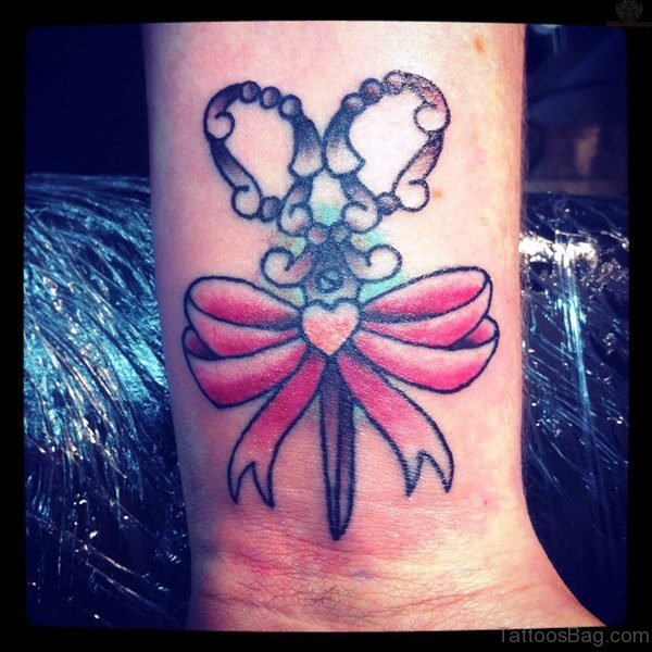 Scissor And Pink Bow Tattoo On Wrist