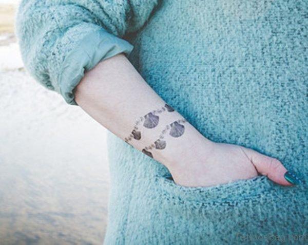 Seashell Tattoo Bracelet On Wrist