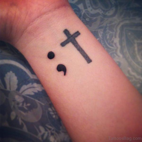Semicolon And Cross Tattoo On Wrist