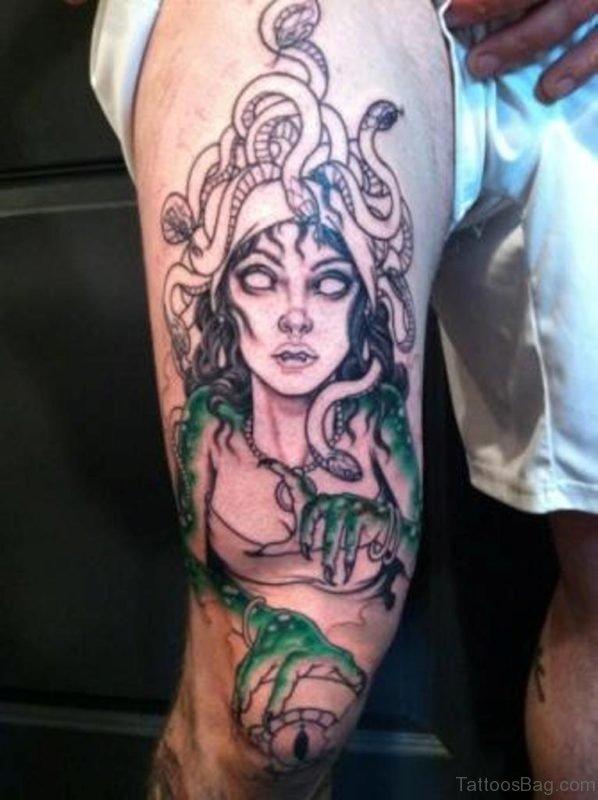 Showing Medusa Tattoo On Thigh
