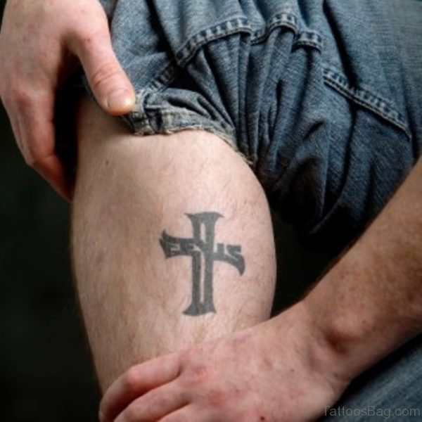 Simple Black Cross Tattoo On Leg Calf