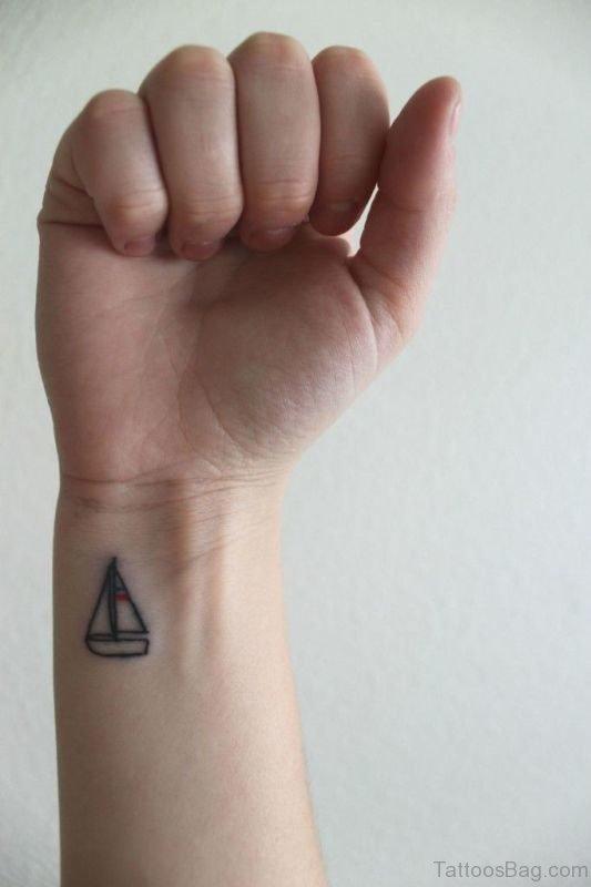 Simple Boat Tattoo On Wrist