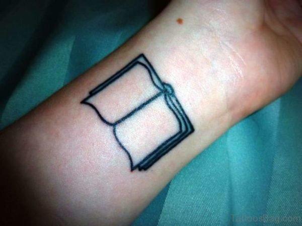 Simple Book Wrist Tattoo
