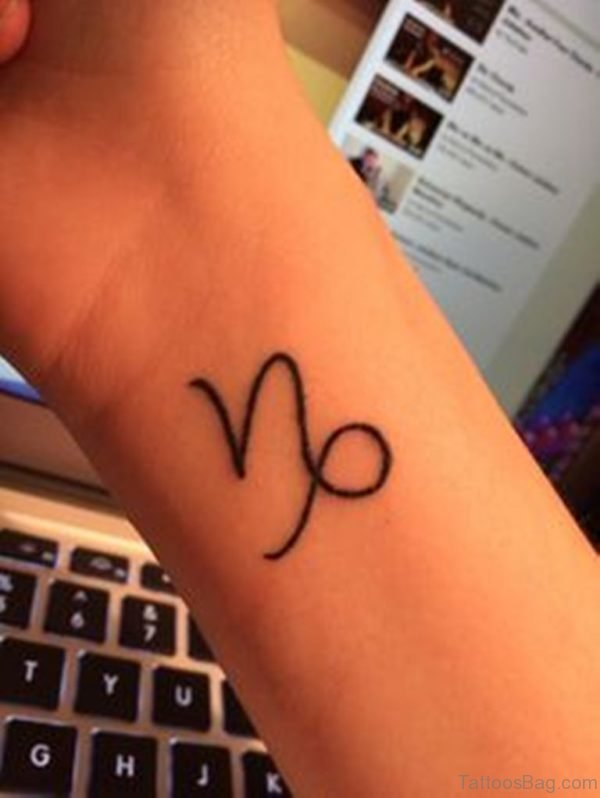 Simple Capricorn Tattoo On Wrist