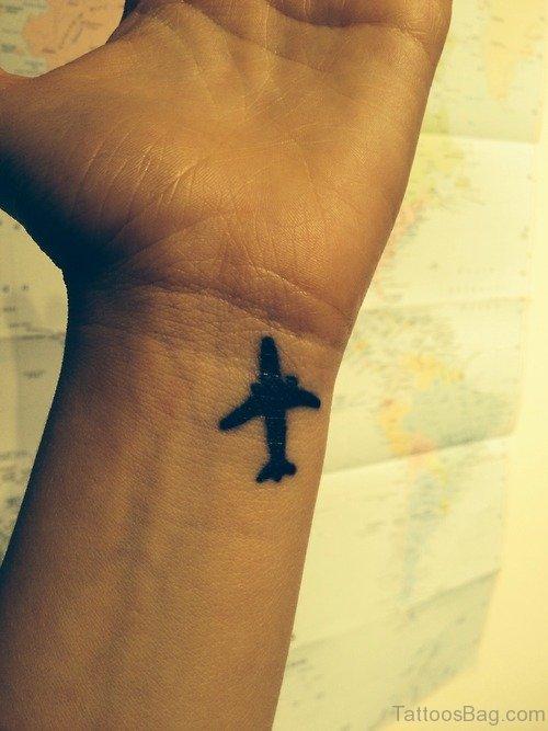 Simple Plane Tattoo On Wrist