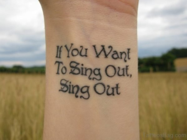 Sing Out Tattoo On Wrist