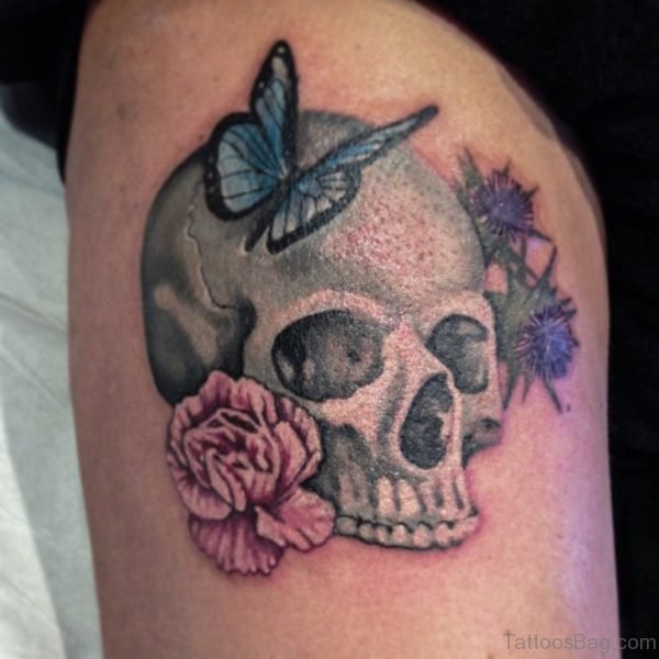 Skull And Butterfly Tattoo On Thigh