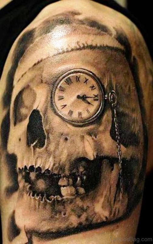 Skull And Clock Tattoo On Left Shoulder